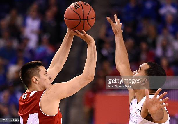 Wisconsin Badgers guard Bronson Koenig shoots the ball under pressure from Kentucky forward Trey Lyles during a NCAA Final Four game between the...