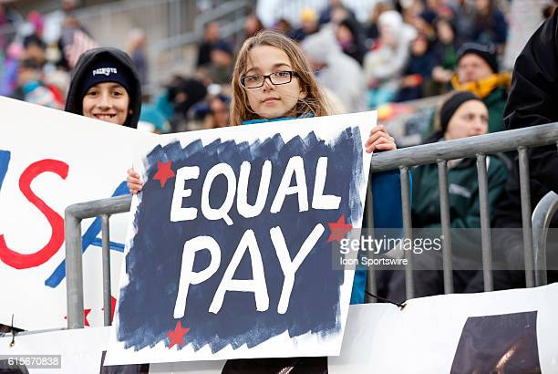 A young USA fan with a message on equality in pay The United States womens national soccer team defeated the womens national team of Colombia 70 in...