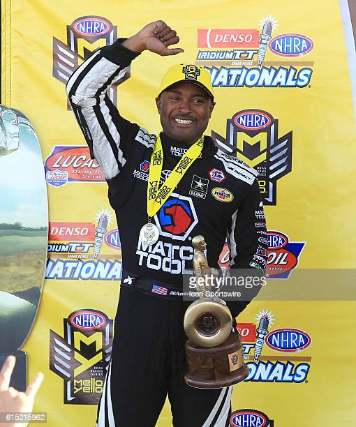 Antron Brown Don Schumacher Racing NHRA Top Fuel Dragster elebrates winning his class during the Denso Spark Plugs NHRA Nationals Sunday April 3 2016...