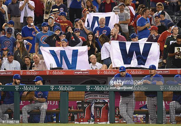 Cubs fans hold up W flags to celebrate the win during an MLB game between the Chicago Cubs and the Los Angeles Angels of Anaheim at Angel Stadium in...