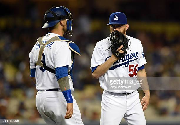 Los Angeles Dodgers Pitcher JP Howell [4933] talks with Los Angeles Dodgers Catcher Yasmani Grandal [8341] during an MLB game between the San Diego...