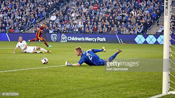 Sporting Kansas City goalkeeper Tim Melia makes the save in a match between Real Salt Lake and Sporting Kansas City at Children's Mercy Park in...