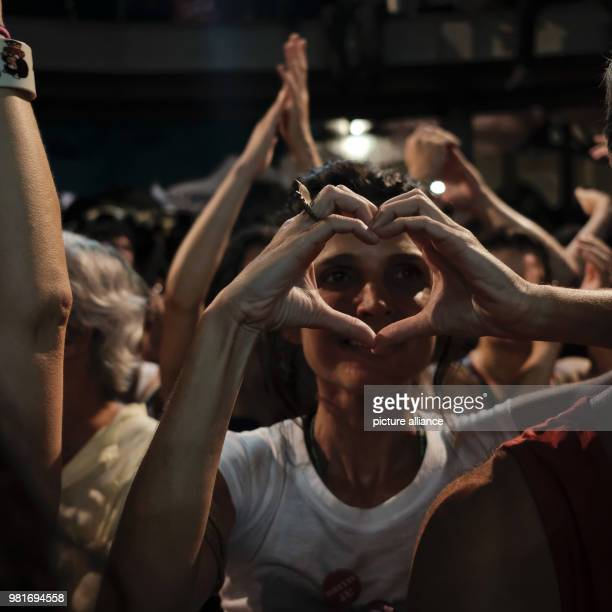 A supporter of Luiz Inacio Lula da Silva former president of Brazil forming a heart shape with her hands at a political event in support of the...