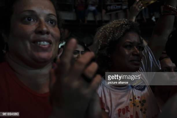 Supporters of Luiz Inacio Lula da Silva former president of Brazil taking part in a political event in support of the leftwing politician Despite a...
