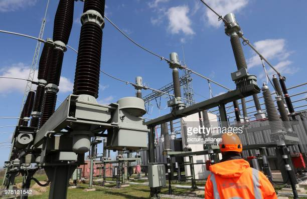 A staff member of grid operator 50Hertz walks through the large switchboard unit at the new transformer substation The German offshore windparks...