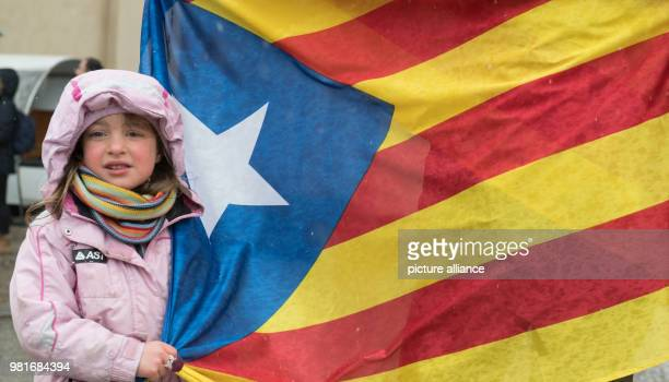 Cecilia and her mother holding a Catalonian flag at a demonstration at the Brandenburg Gate The citizens' initiative Assemblea Nacional Catalana...