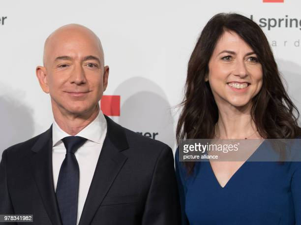 Head of Amazon Jeff Bezos and his wife MacKenzie Bezos arrive for the Axel Springer award ceremony Bezos will be receiving the award later Photo...