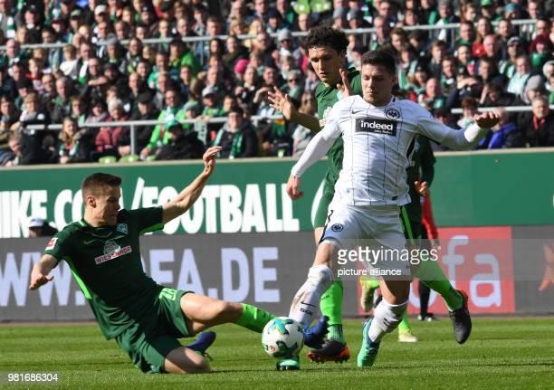 soccer Bundesliga Werder Bremen vs Eintracht Frankfurt in the Weser stadium Werder's Niklas Moisander and Milos Veljkovic and Frankfurt's Luka Jovic...