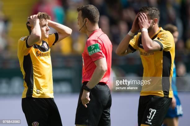Soccer Second Bundesliga Dynamo Dresden vs Holstein Kiel at the DDV Stadium Dresden's Niklas Hauptmann and Pascal Testroet react next to referee...