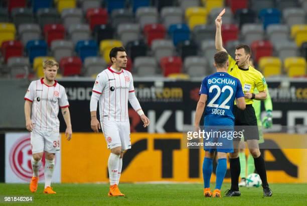 Soccer 2nd Bundesliga Fortuna Duesseldorf vs VfL Bochum in the Esprit Arena Match referee Felix Zwayer showing Duesseldorf's Kaan Ayhan the red card...