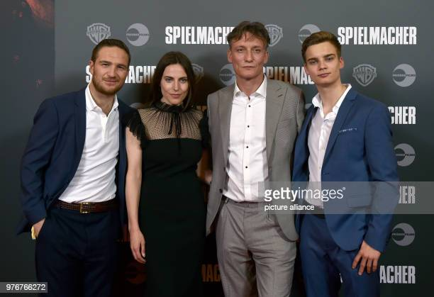 The actors Frederick Lau Antje Traue Oliver Masucci and Mateo Wansing Lorrio attend the premiere of their film 'Spielmacher' at the Lichtburg cinema...