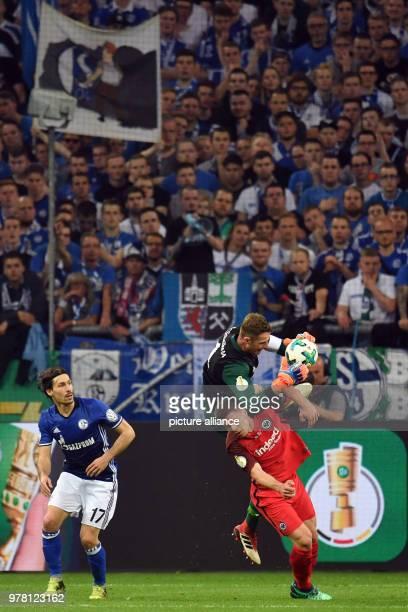 Football DFB Cup FC Schalke 04 vs Eintracht Frankfurt semifinal at the Veltins Arena Schalke's goalie Ralf Faehrmann and Frankfurt's Luka Jovic Photo...