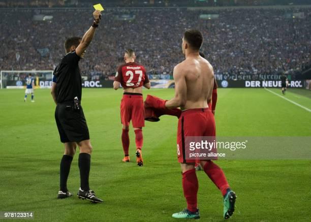 Football DFB Cup FC Schalke 04 vs Eintracht Frankfurt semifinal at the Veltins Arena Frankfurt's goalscorer for 10 Luka Jovic celebrates shirtless...