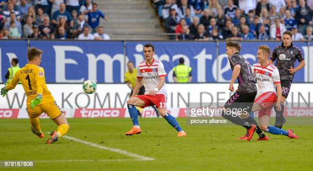 Football German Bundesliga Hamburg SV vs SC Freiburg at the Volksparkstadion Hamburg's Lewis Holtby scores to make it 10 against Freiburg goalie...