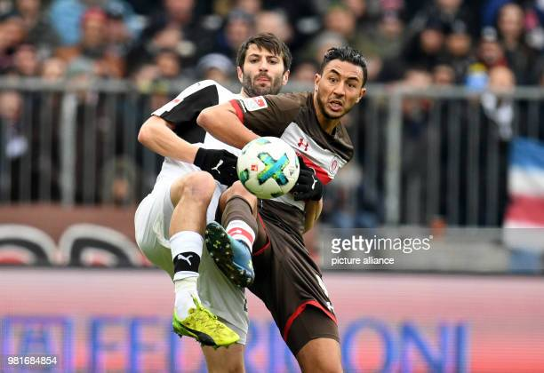 soccer 2nd Bundesliga FC St Pauli vs SV Sandhausen in the Millerntor stadium Pauli's Aziz Bouhaddouz and Sandhausen's Markus Karl vying for the ball...