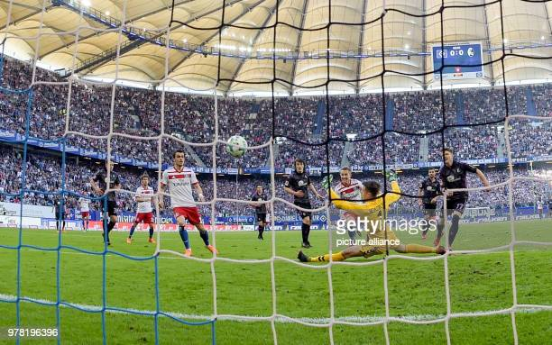 Soccer Bundesliga Hamburger SV vs SC Freiburg at the Volksparkstadium Hamburg's Lewis Holtby scores the 10 Photo Axel Heimken/dpa IMPORTANT NOTICE...