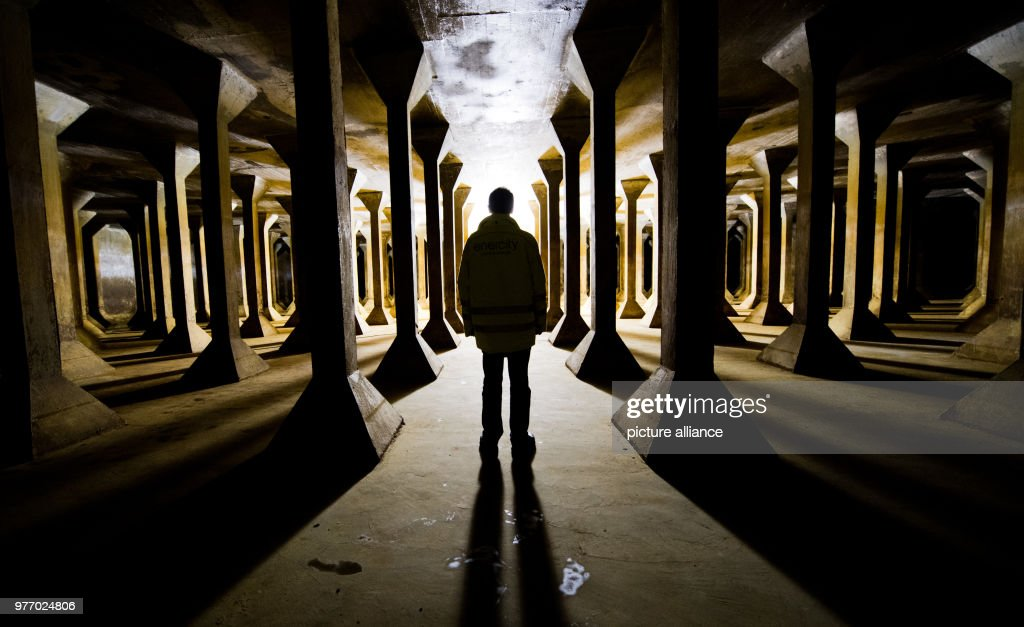 An enercity worker standing in the empty no longer used water storage tank Messe- & Underground water storage tank before demolition Pictures | Getty Images