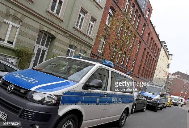 Police wagons in front of residential buildings in Hanover's district of Linden The federal police force conducted raids in three Hanover96 ultras...