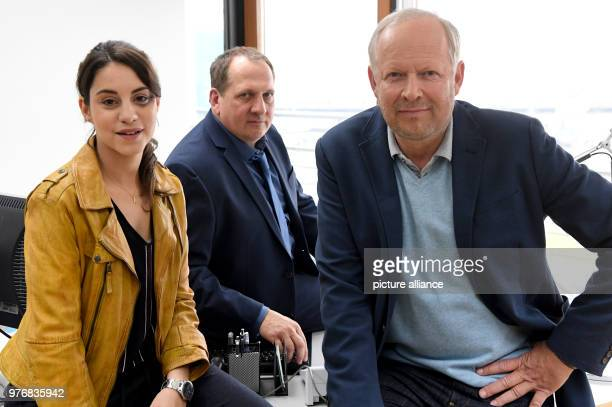 Actors Axel Milberg Thomas Kuegel and Almila Bagriacik stand together during a photocall on the set of a new episode of the Tatort crime series...