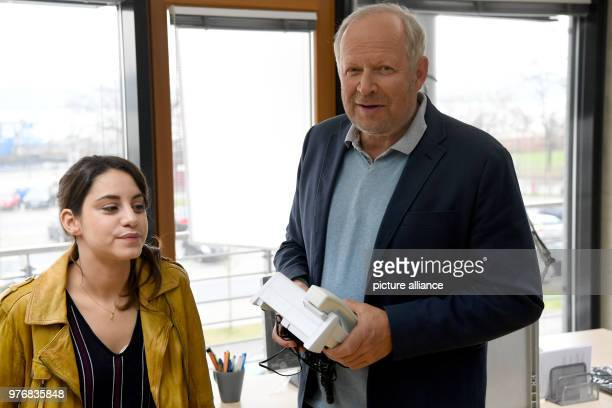 Actors Axel Milberg und Almila Bagriacik laugh during a photocall on the set of a new episode of the Tatort crime series Milberg and Bagriacik are...