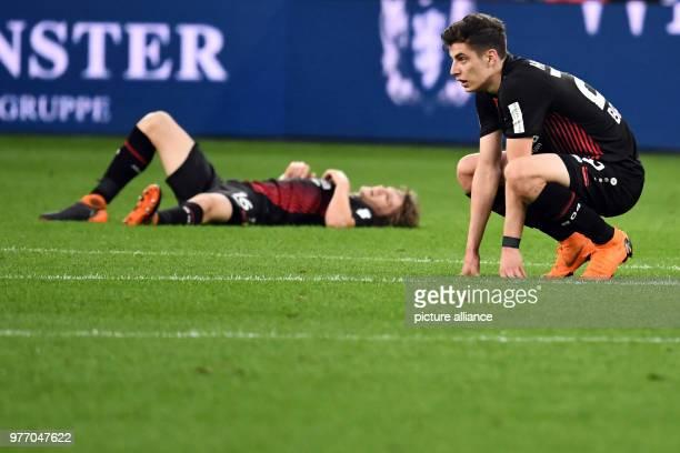 Soccer Bundesliga Bayer Leverkusen vs VfB Stuttgart in the BayArena Leverkusen's Kai Havertz and Tin Jedvaj lying and crouching on the pitch after...