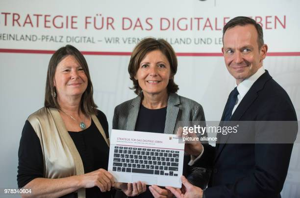 Minister of Environment Ulrike Hoefken of the Alliance 90/The Greens Premier Malu Dreyer of the Social Democratic Party Minister of Economy Volker...