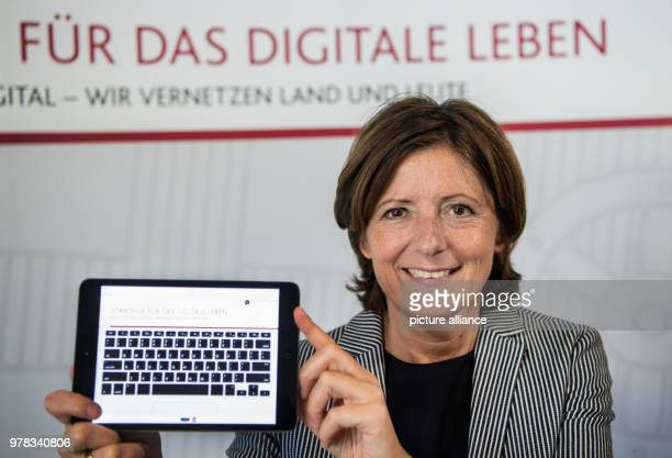 Premier of RhinelandPalatinate Malu Dreyer of the Social Democratic Party holding a symbolic keyboard during a presentation of the digitalization...
