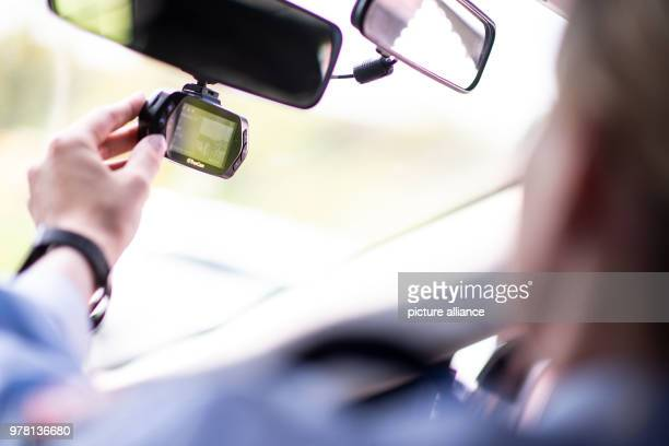 A police officer operates the dashcam of a police car during a press event The freeway police in North RhineWestphalia is going to be equipped with...