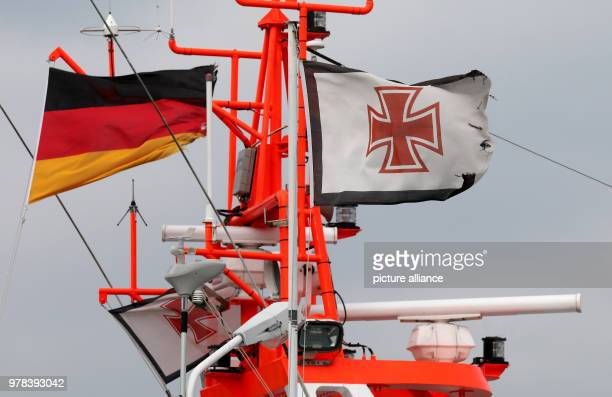 TheGerman flag and that of the DGzRS waving in the wind aboard the Theo Fischer rescue cruiser at the German Maritime Search and Rescue Service's...