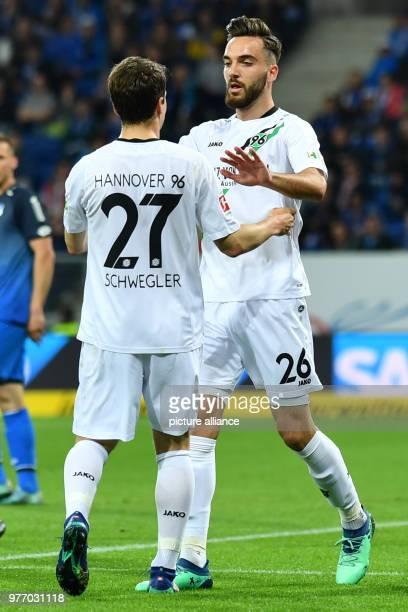 Bundesliga 1899 Hoffenheim vs Hannover 96 in the Rhein Neckar Arena Hannover's Kenan Karaman and Pirmin Schwegler celebrating the 11 equaliser Photo...
