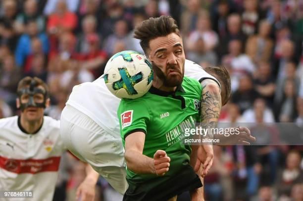 Soccer Bundesliga VfB Stuttgart vs Hanover 96 at the MercedesBenzArena Hanover's Kenan Karaman and Stuttgart's Daniel Ginczek vie for the ball Photo...