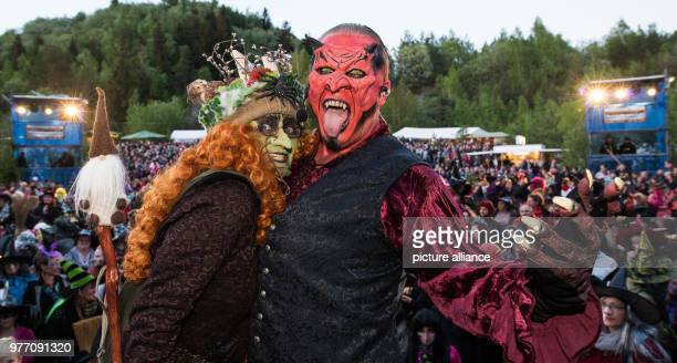 30 April 2018 Germany Wolfshagen Im Harz Antje Wedde dressed as a witch and Jan Abraham dressed as a devil standing onstage before an attempt at a...