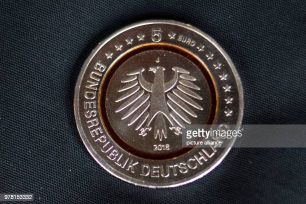 A new 5 euro collector coin lying on a black fabric The German Bundesbank introduced the new voin in Hamburg on Thursday which is limited to 34...