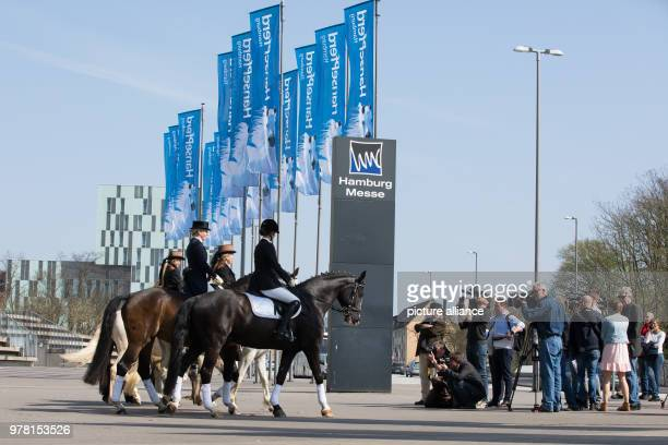Riders with their horses standing during a photo session for the 'Hansepferd' fair in front of the fair halls Event organizers are expecting about 50...