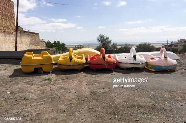 Children's boats that are no longer usable lie in the backyard of the meanwhile closed beach hotel Fanus With the gradual drying up of Lake Urmia and...