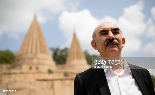 Ido Baba Sheikh standing in front of a temple in Lalish in north Iraq Minister for Development Mueller is visiting the camp as part of his trip to...