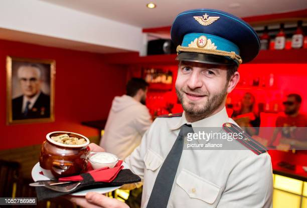 Owner Anton Djacenko served in historical KGB uniform fresh Wareniki 'Ukraina' dumplings with potato filling in the KGB bar With many Soviet relics...