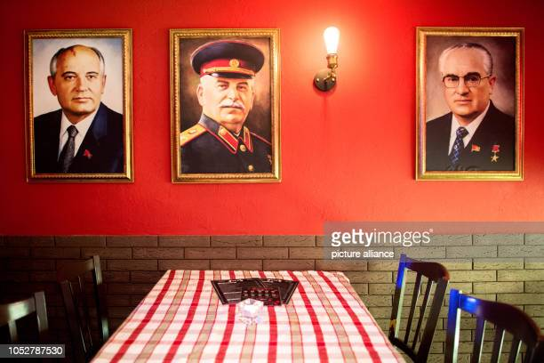 The portraits of former Soviet politicians Mikhail Gorbachev Josef Stalin and Yuri Andropov hang in the KGB bar With many Soviet relics the bar in...