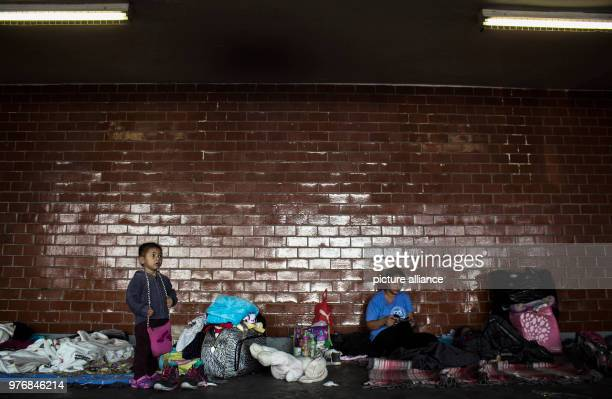 A child and a boy await for further transportation through Mexico Every year numerous migrants from Honduras Guatemala and El Salvador set out for...