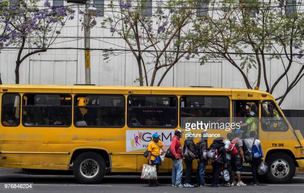 A group of migrants board a local bus to train station near the capital city Every year numerous migrants from Honduras Guatemala and El Salvador set...
