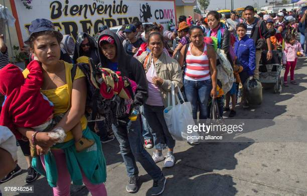 Migrants stand in line awaiting further transportation through Mexico Every year numerous migrants from Honduras Guatemala and El Salvador set out...