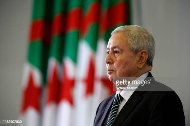 Abdelkader Bensalah Interim President of Algeria observes the Algerian national anthem at the Palace of the Nation Algeria's parliament on Tuesday...