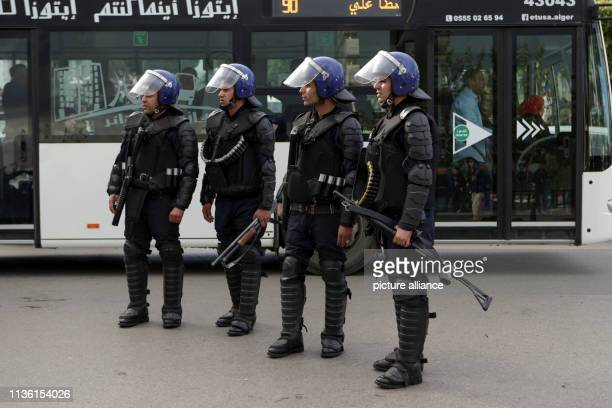 Algerian policemen take position during an antigovernment demonstration Algerians continued to demonstrate although newly appointed interim president...