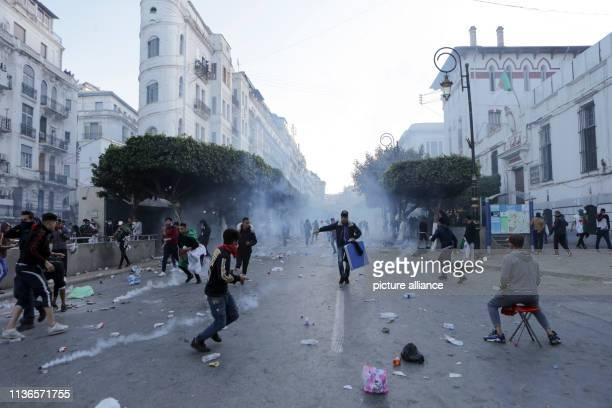 Algerian protesters clash with security forces during an antigovernment demonstration Thousands of Algerians defied police cordons on Friday and...