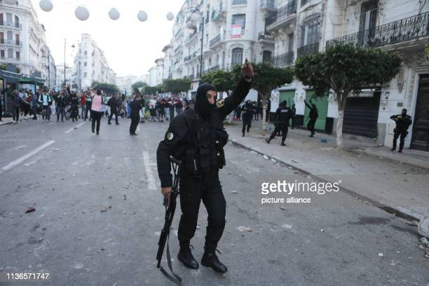 Algerian security forces clash with protesters during an antigovernment demonstration Thousands of Algerians defied police cordons on Friday and...
