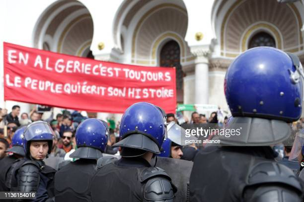 Algerian security forces surround protesters during an antigovernment demonstration Algerians continued to demonstrate although newly appointed...