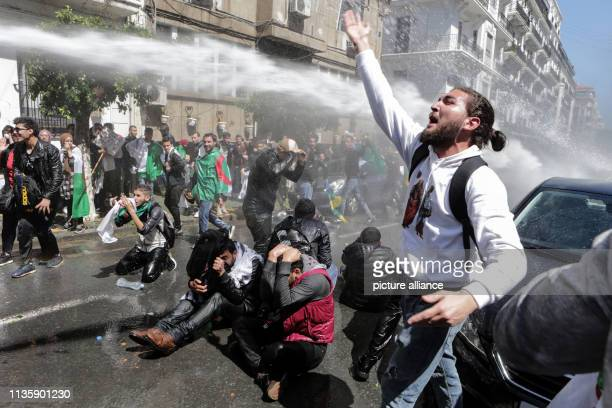 Algerian security forces use water canons to disperse protesting students during an antigovernment demonstraion The Algerian parliament declared the...
