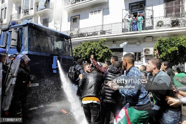 April 2019, Algeria, Algiers: Algerian security forces use water canons to disperse protesting students during an anti-government demonstraion. The...