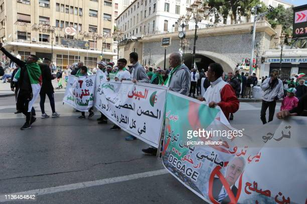 Algerians hold banners as they take part in protest against the newly appointed interim president Abdelkader Bensalah Photo Farouk Batiche/dpa