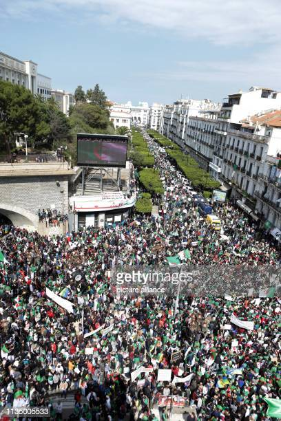April 2019, Algeria, Algiers: Algerians take part in an anti-government demonstration to demand an overhaul of the political system after...